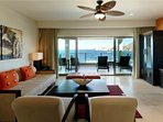 Looking from dining area into family room and onto balcony that overlooks Medano Beach and the arch