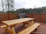Grill and picnic table on the deck