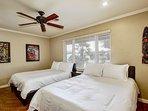 Spacious 4th bedroom has 2 queen beds / TV