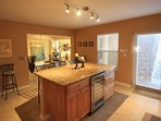 Large kitchen island showing wine fridge.