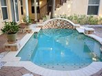Beautiful courtyard splash pool.  Great way to cool off!