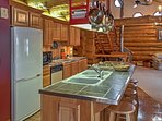 The kitchen comes fully equipped with all the essential appliances and utensils.