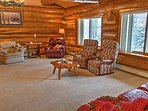 Boasting 4,300 square feet of twisting cedar logs and tastefully appointed living space, this spacious, homey cabin is...
