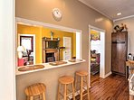 The kitchen bar adds additional seating for 3 guests.