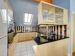 Spacious well equipped kitchen leading through to dining area and lounge.