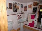 Bathroom with original Edwardian claw-foot bath & shower over