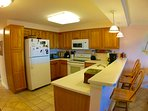 Prepare meals in a fully equipped kitchen.