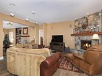 family and living room with two fireplaces. Opens to kitchen