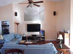 central living area where you all can hang out - comfortable seating for everyone, 55' flat TV