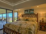 Master Bedroom with Cal-king bed set opens to lanai and has built-in closets & 4K smart Roku UDTV.
