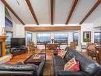 "Living room has a wall of windows to see the ocean, morro bay and coastal mountains. 55"" smart TV"