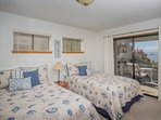 Lower floor room with 2 full beds, sleeps 2-4.  With private patio and set with expansive ocean view