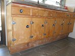 These antique cupboards in the kitchen were made of the hoop pine that grows on the headlands.