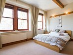 Largest of the 1st floor bedrooms with double bed, pine wardrobes and fireplace