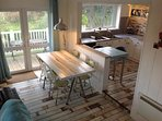 Kitchen Dining area with patio doors leading out to lower balcony
