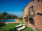 Villa Mandorlo's swimming pool from the back of the house