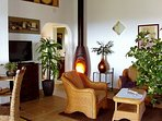 Living room with fire place (apart from central heating), bathroom door seen in the