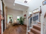 The double height entrance hall is framed by 2 magnificent stone pillars from the 17th Century Hall