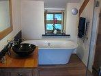 Solid oak underfloor heated bathroom.