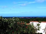 Panorama view towards the ocean from the conservatory and inside the house