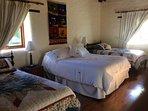 2nd bedroom off front porch.  Adjacent full bath and W/D room