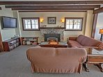 Relax on the plush couches next to the fireplace in the living area.