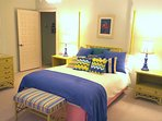 Recently updated bedroom, featuring queen bed, down comforter, and full bathroom