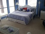 Bedroom with panoramic view of Little Bay.  King bed with half bath.