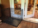 Large dog crate on lower covered deck