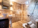 Family bathroom/wetroom with large walk-in shower