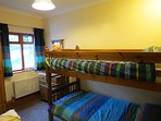 Full size bunk beds in the second bedroom.
