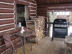 Your front porch with firewood and BBQ grill.