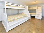 A pair of Twin over Full bunks, 1 with a trundle