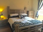 Master Bedroom with New kingside bed, furniture and 30' flat screen tv
