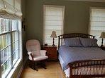 Master bedroom with TV, attached bath w/ walk-in shower, Sleep # mattress to adjust firmness.