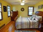Second bedroom on first floor with queen bed