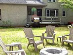 Backyard with deck  gas grill and firepit