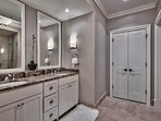 The dual sinks in the master en suite will please any guest.
