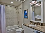 The final guest bathroom has a shower/tub combo for added convenience.
