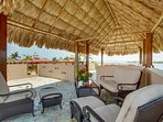 Rooftop Palapa with comfy chairs and table