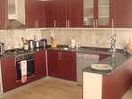 The open plan kitchen is fully equipped