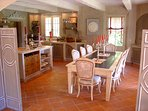 Winter kitchen and dining room in one room which keeps volumes and allows more convenience
