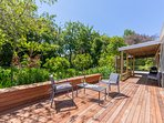 Sunny north facing deck, covered entrance and BBQ