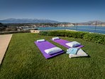 Yoga classes by the seafront with the imposing White Mountains in the background