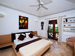 Bedroom 2 main house, with en suite, ceiling fan, airconditioning, dressing room, safe and good WiFi