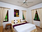Cottage bedroom 2 with ceiling fan, airconditioning, safe and good Wi Fi