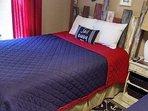 2 queen beds with Serta Trump elite mattresses.