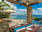 Outdoor dining area, swimming pool & sea view