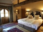 Superking bed , arched doors leading to terrace and garden . TV . Ensuite and large bath.
