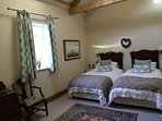 Twin bedroom with large continental single beds , with ensuite and TV